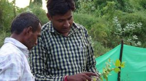 Mr. Nitin Vaishnav (right) with a farmer
