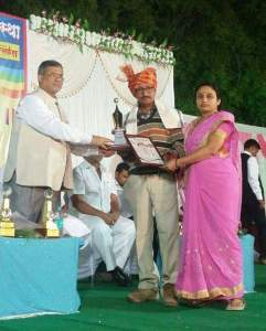Mrs and Mr. Wani being felicitated for their progressive farming methodology