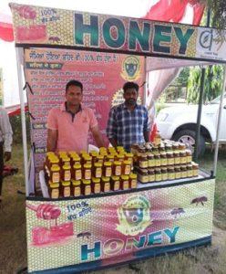 Beekeeper Narpinder Singh (L) selling honey and bee pollen